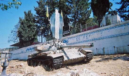 Abandoned Tiran 5 Tank With Khomeini Poster