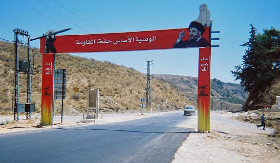 Hezbollah sign over the highway in South Lebanon near the Litani River PD